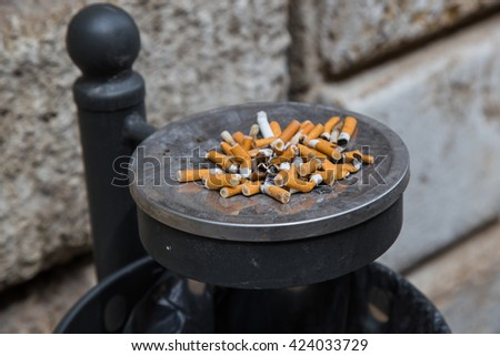 Ashtray full of cigarette butts - stock photo