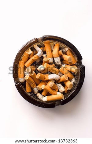 Ashtray full of cigarette butts isolated on white background - stock photo
