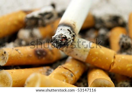 Ashtray full of cigarettes - stock photo