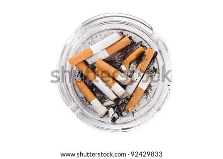 Ashtray full of cigarettes. Isolated on white. - stock photo