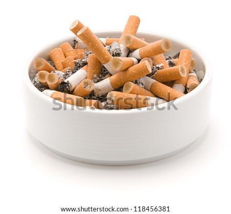 Ashtray full of smoked cigarettes isolated on white background - stock photo