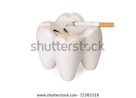 Ashtray in the form of a tooth with a stub on a white background - stock photo