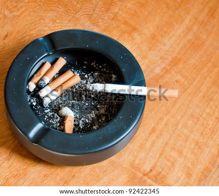 ashtray on wood table - stock photo