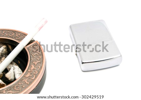 ashtray with cigarette and butts, and lighter on white - stock photo