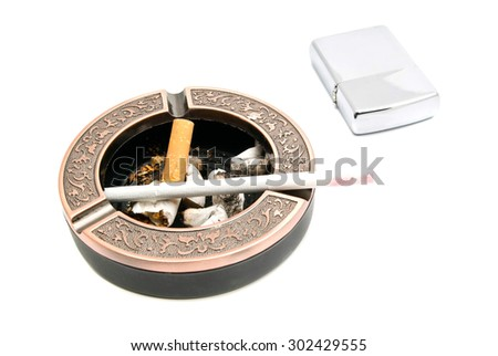 ashtray with cigarette and butts, and lighter on white closeup - stock photo