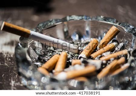 ashtray with cigarettes - stock photo