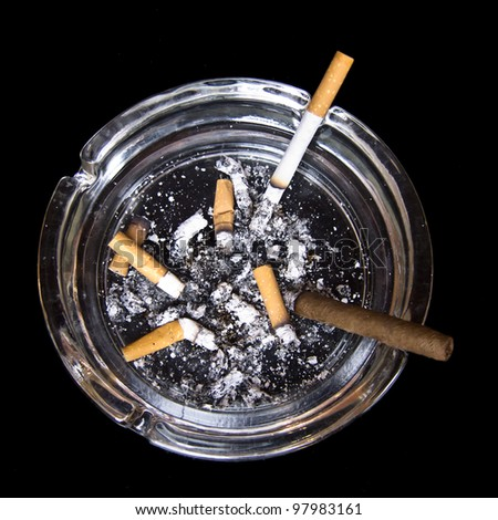 Ashtray with cigarettes and tobacco - stock photo