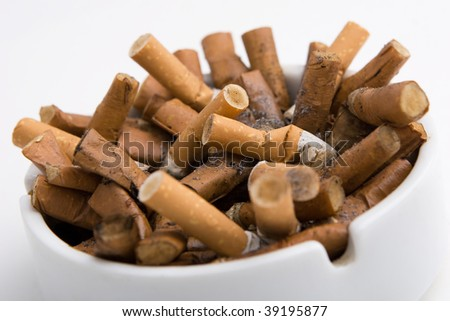 Ashtray with cigarettes on white
