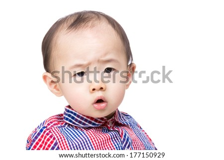 Asia baby boy feeling worries  - stock photo