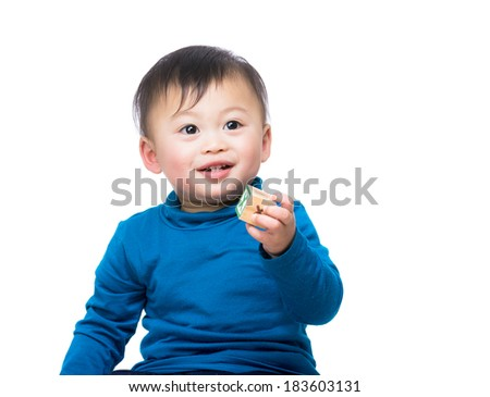 Asia baby boy holding toy block