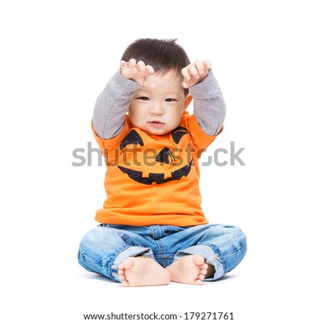 Asia baby boy with halloween dressing and hands up - stock photo