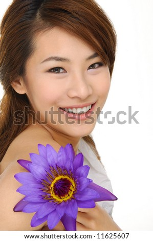 asia Beautiful girl with lily flower - stock photo