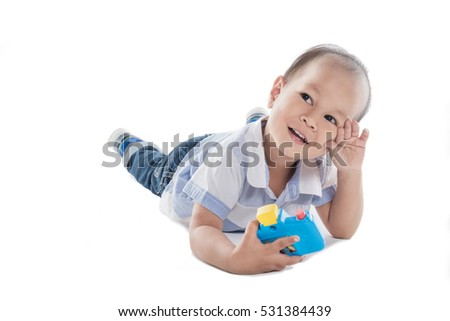 Asia boy with a camera, Boy joyful mood,white background.