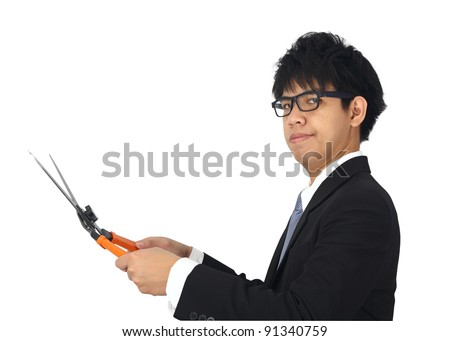Asia Business Man holding scissors grass on white  background - stock photo