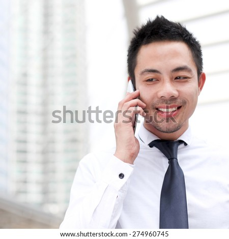 Asia business man using a mobile phone with copy-space. - stock photo