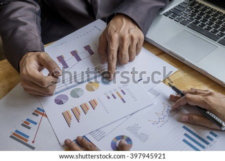Asia business people discussing the charts and graphs showing the results of their successful teamwork.Vintage tone Retro filter effect,soft focus,low light.(selective focus)  - stock photo