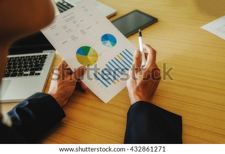 Asia business people discussing the charts and graphs showing the results of their successful teamwork. Vintage tone Retro filter effect,soft focus,low light.(selective focus). Business concept.  - stock photo