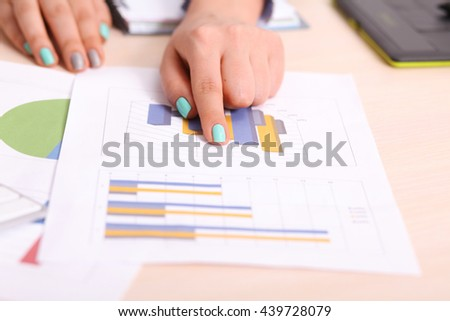 Asia business woman analyzing investment charts on desk.vintage tone Retro filter effect,soft focus,low light.(selective focus)