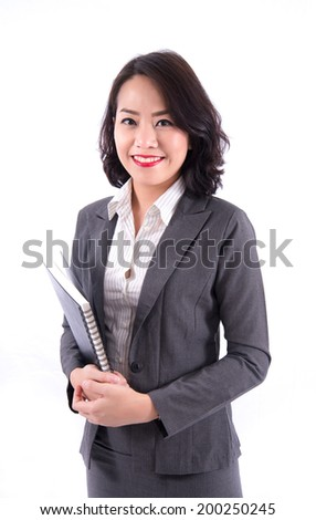 Asia business woman holding notebook - stock photo
