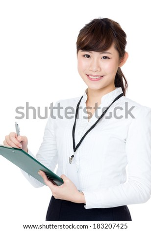 Asia business woman writing on clipboard