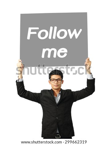 Asia businessman show wording follow me on paper board over white background, clipping path.