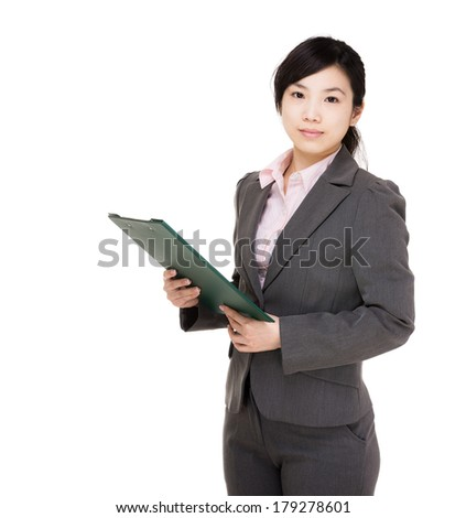 Asia businesswoman with filepad - stock photo