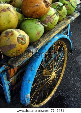 Asia concept: Tropical coconuts vendor's grunge vehicle for business - stock photo