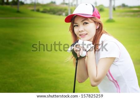 Asia girl golf player  - stock photo