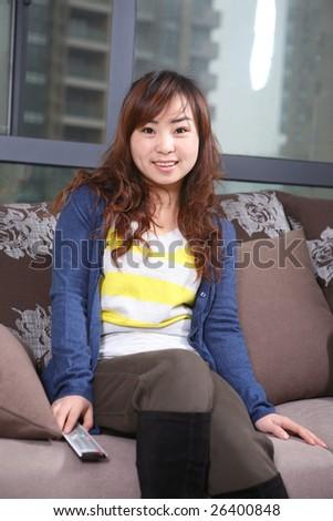 asia girl watch TV - stock photo