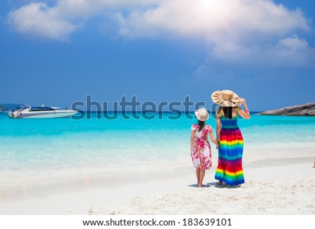 Asia mother and her daughter in Tropical beach, Similan Island, Andaman Sea, Thailand - stock photo