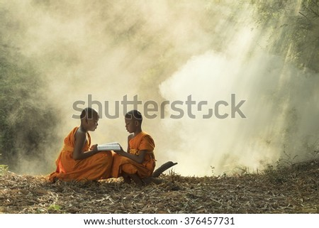 Asia, Novice reading  book  of  buddhism Thailand.