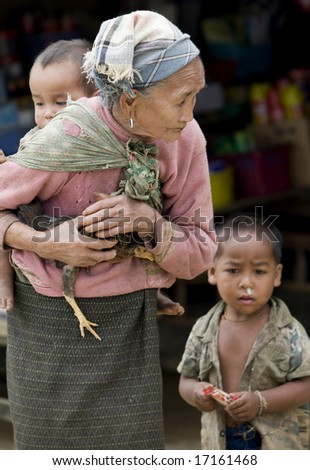 Asia, old woman with chicken and grandson