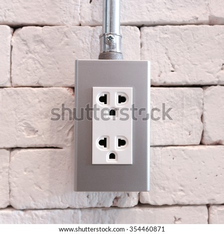 Asia plug socket on brick wall background. - stock photo