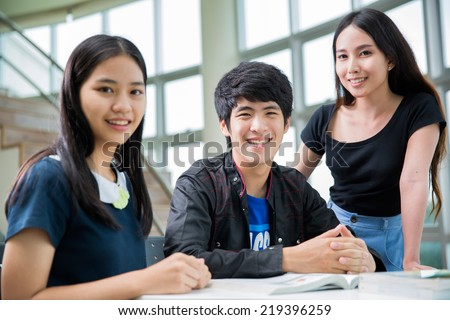 Asia students group read a book in Library - stock photo