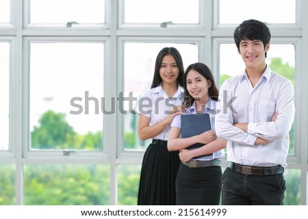 Asia students read a book  in Library with uniform - stock photo