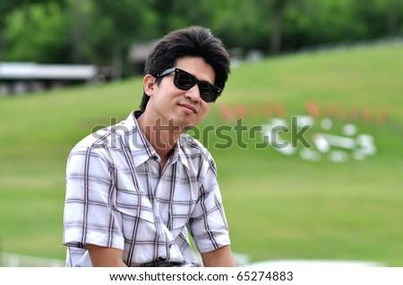 Asia Thailand Man Sunglasses Happy Smile - stock photo