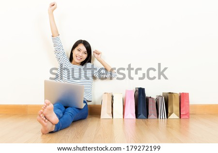Asia woman excited about shopping online - stock photo