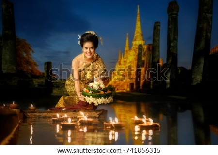 Asia woman in Thai dress traditional hold kratong, Loy Krathong Day is one of Thailand most important day.