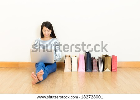 Asia woman online shopping at home - stock photo