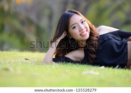 asia woman relaxing in the park