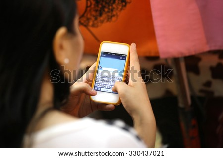 asia woman use phone,using mobile smart phone, Internet of things lifestyle with wireless communication and internet with smart phone.  - stock photo