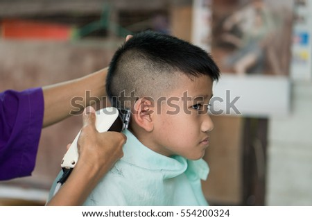 Asia Young Boy Getting A Haircut Before Back To School