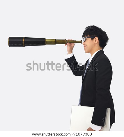 asia young business man looks through a telescope
