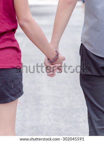 asia young couple in love park - stock photo