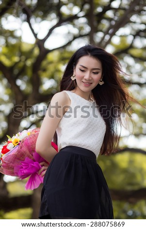 Asia young cute woman smile white  bouquet  flowers - stock photo