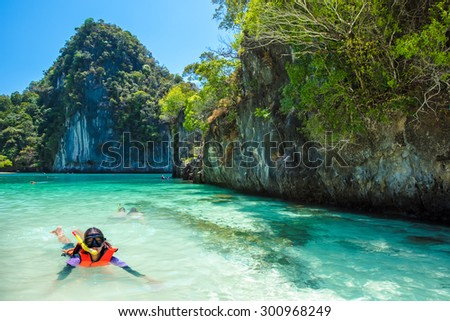Asia Young lady snorkeling in Tropical beach scenery, Andaman sea, View of koh hong island krabi,Thailand - stock photo