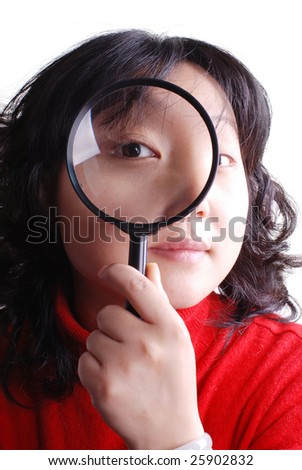 Asia young woman holding magnifier on white background - stock photo