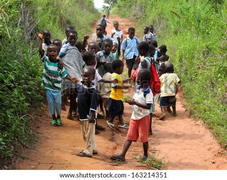 ASIAFO AMANFRO, EASTERN, GHANA - NOVEMBER 14: Unidentified Ghanaian pupils on November 14, 2011 in Asiafo Amanfro, Ghana. Children from the rural school for the Akaa community. - stock photo