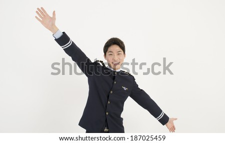Asian airline pilot stretch his arms - stock photo