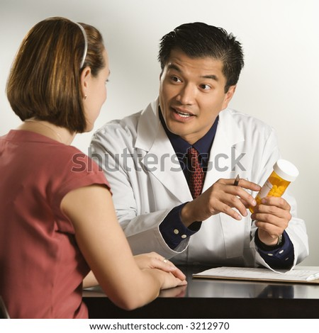 Image result for asian male doctor with female patient